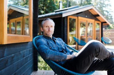 Jesse Keefer sits on a porch at Bodega Cove