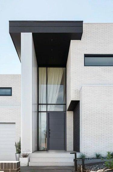 modern exterior door in black with linear doorway