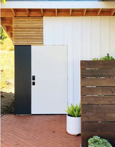 Modern garden shed with board and batten exterior and other siding