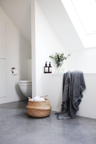 minimalist bathroom with concrete flooring