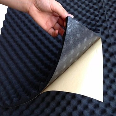 Acoustic foam with adhesive backing.