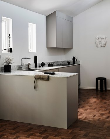 minimalist small kitchen idea with wood flooring and gray cabinets
