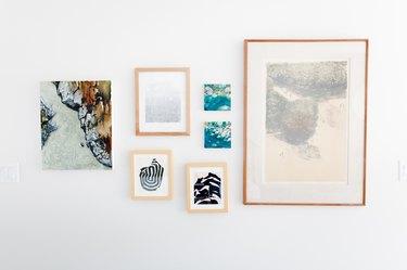 abstract artwork hung on wall