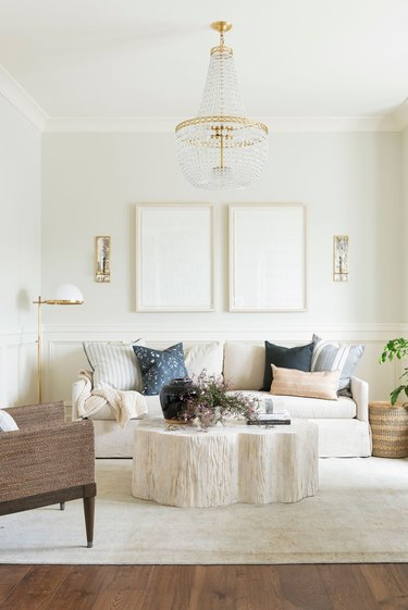 ivory color idea in sitting room with crystal chandelier and ivory furniture