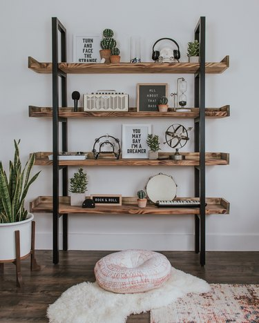 diy industrial bookshelf with black ladder detail