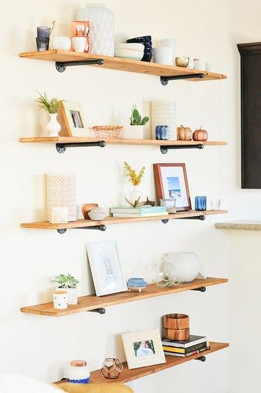 floating DIY industrial bookshelf with decor