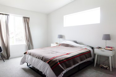 Minimalist bedroom with wool blanket on bed