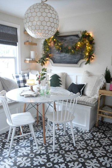 Rustic Christmas decorations in breakfast nook with throw pillows and garland