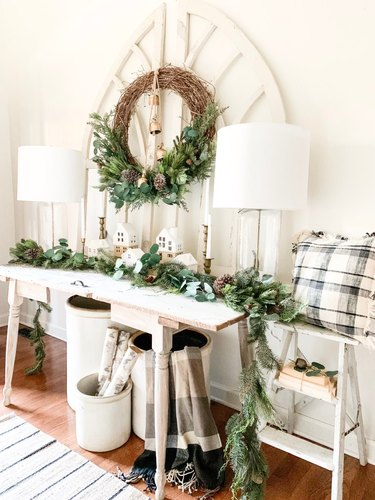 Rustic Christmas decorations in entryway with vintage pieces and winter garland