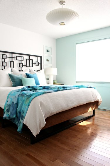 modern bedroom with aqua color accent wall