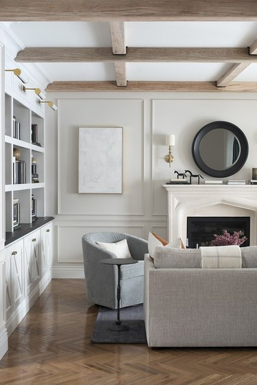 ivory color idea in formal living room with ivory walls and sunwashed wood beams