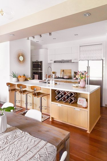 Blonde wood island in a white kitchen