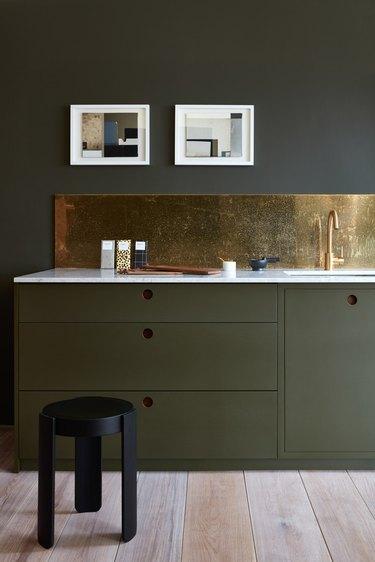modern kitchen backsplash idea with green kitchen green cabinets and walnut details