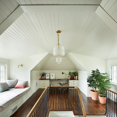 attic idea with office and shiplap ceiling and bench seat
