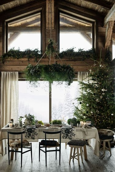 rustic dining room with Christmas window decorations