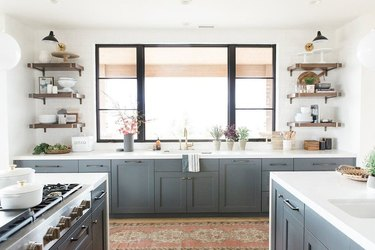 blue kitchen cabinet color with white countertops and open shelving