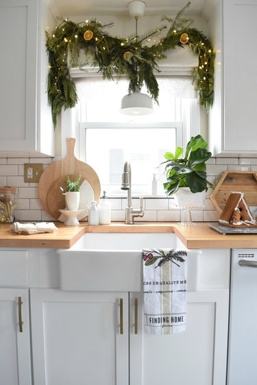 white kitchen with Christmas window decorations