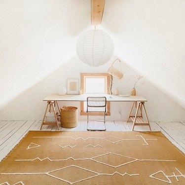 minimalist attic office idea with ochre rug and wood desk