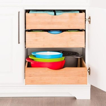 small kitchen organization idea with roll out drawers in the cabinet