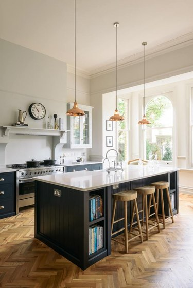 Kitchen pendant lighting hung from high ceiling