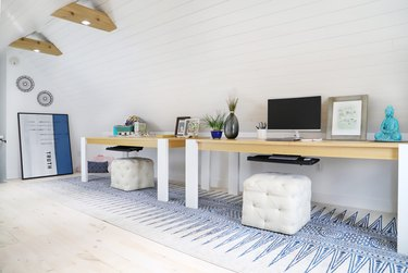 attic office idea with two desks and square poufs
