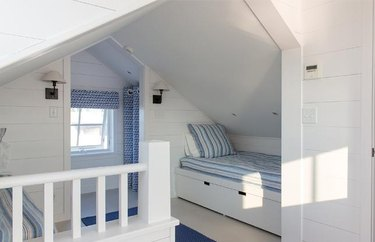Small attic ideas with nautical decor in light blue with hard edged walls.