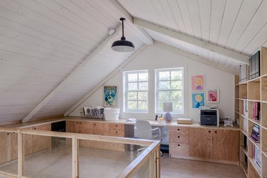 attic office idea with tongue and groove ceiling and custom plywood desks and bookcase