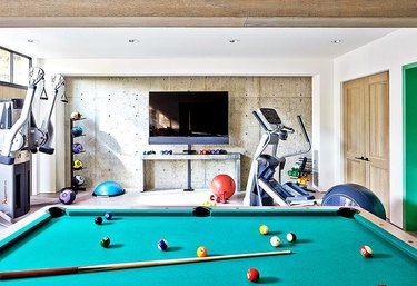 basement gym and game room with pool table
