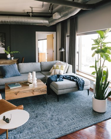 industrial style apartment living room with exposed HVAC system