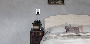 bedroom space with gray wall