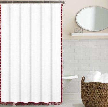 Red tasseled shower curtain