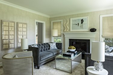 Living room layout idea with matching tufted sofas near fireplace