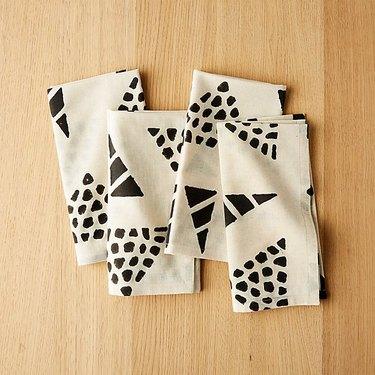 four black and white napkins