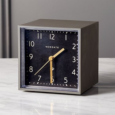 grey and black alarm clock