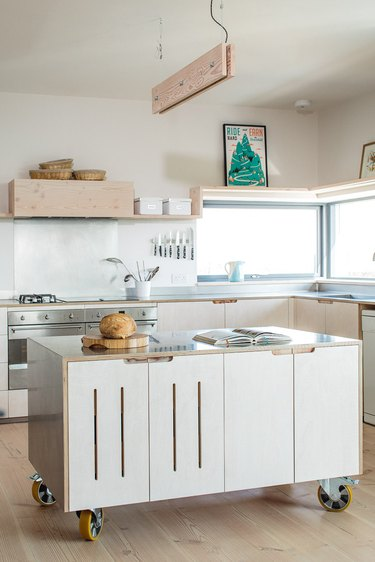 small kitchen storage idea with movable island that contains storage