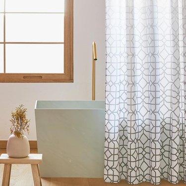 geometric print shower curtain in modern bathroom