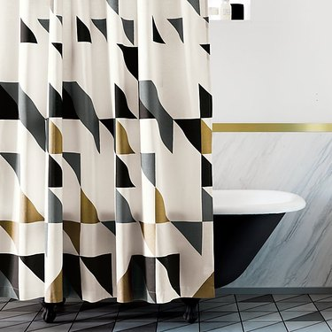 patterned shower curtain near tub