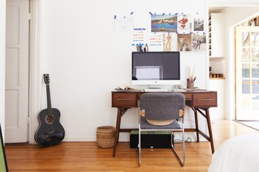 Home office with wood floors and guitar