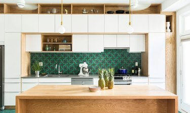 midcentury style green kitchen backsplash in white and oak kitchen