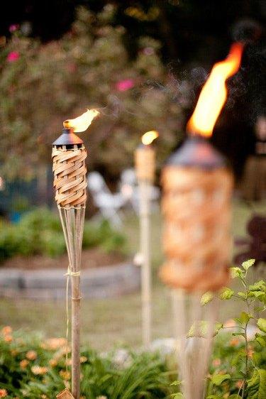 outdoor tiki torches in backyard