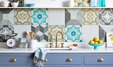 patterned wood floor tile kitchen backsplash with blue cabinets