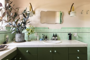 trending bathroom lighting in retro bathroom with green tiles and pink walls