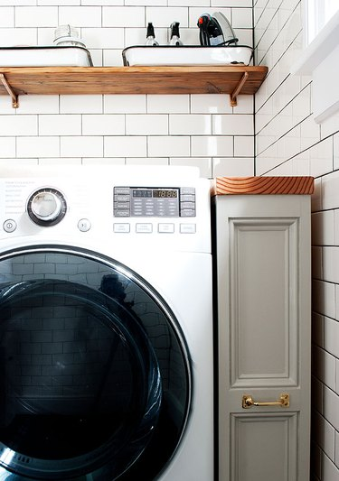 rolling storage cabinet in laundry room