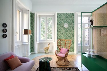 living room with green floral wallpaper