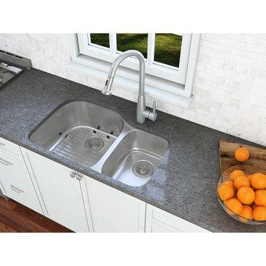 Faucet on granite countertop.