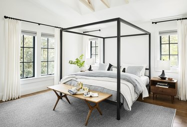 Bedroom layout idea with a bench at the foot of the canopy bed