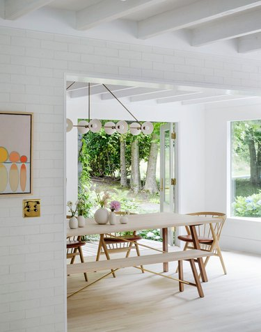 Scandinavian dining room with dining chairs and bench