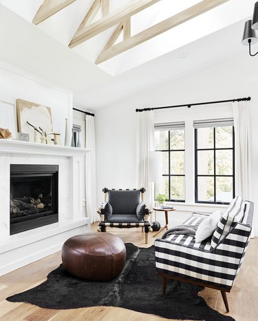 bedroom layout idea with seating area in front of fireplace