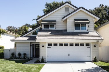Garage on white traditional house