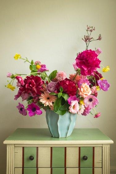 floral arrangement on striped dresser
